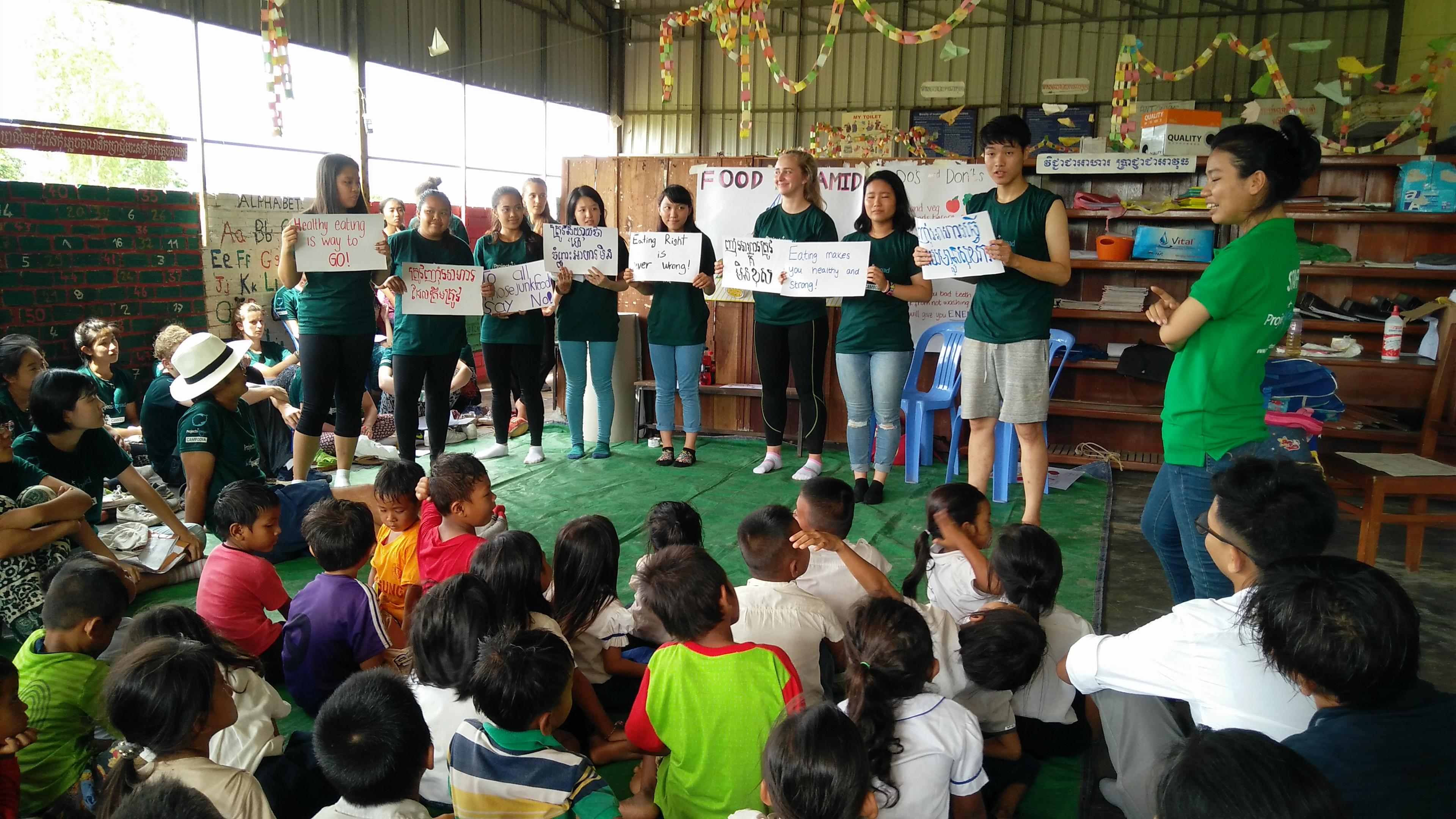 Interns run a healthy eating campaign as part of their Public Health work for teenagers in Cambodia.
